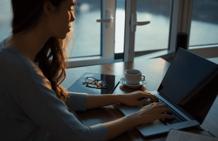 woman-working-computer-alone