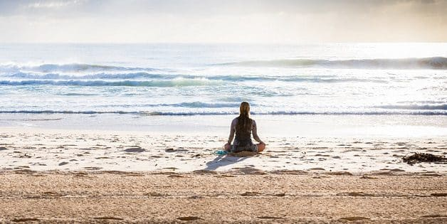 mountain-girl-meditate-beach
