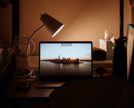 computer and lamp on a desk